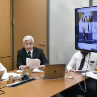 Democratic Party for the People lawmaker Shiori Yamao (left) discusses diplomacy with China with former Defense Minister Gen Nakatani (center) and lawmakers in different countries on March 4. | KYODO