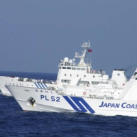 Japan Coast Guard vessels have repeatedly clashed with or chased off Chinese vessels from the waters around the Senkaku Islands in recent years. | JAPAN COAST GUARD / VIA REUTERS
