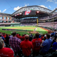 Fans stand for the national anthems of Canada and the United States before the Rangers host the Blue Jays on Monday in Arlington, Texas. | USA TODAY / VIA REUTERS