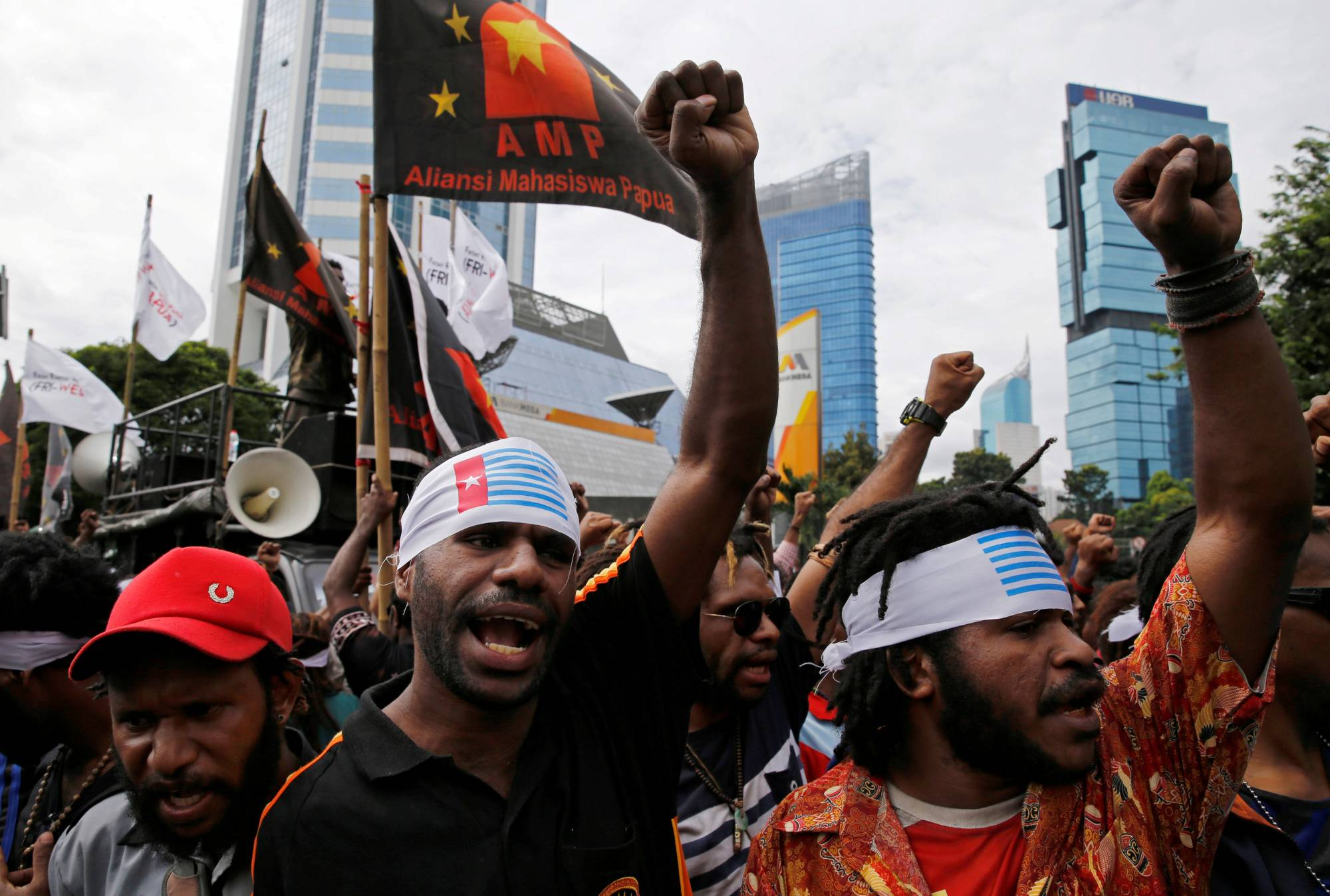 Protesters shout slogans during a rally calling for their right to self-determination in the Indonesian controlled part of Papua, in Jakarta in 2016. | REUTERS