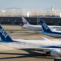 Struggling Japanese airlines are seconding more employees to other companies amid the coronavirus pandemic. | BLOOMBERG