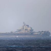 The Chinese aircraft carrier Liaoning sails through the Miyako Strait near Okinawa on its way to the Pacific in this photo released Sunday.  | JOINT STAFF OFFICE OF THE DEFENSE MINISTRY / VIA REUTERS