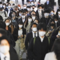 Tokyo's Shinjuku Ward on Tuesday. Experts have voiced concerns about an explosive spread of the virus unlike anything seen before if cases involving variant strains increase in the Tokyo metropolitan area. | KYODO