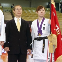 Karate official quits over bullying claim