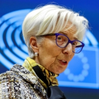 European Central Bank President Christine Lagarde addresses European lawmakers during a plenary session at the European Parliament in Brussels on Feb. 8.   POOL / VIA REUTERS