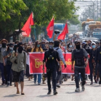 This photo taken from an anonymous source via Facebook on Tuesday shows a demonstration against the military coup in Mandalay, Myanmar. | ANONYMOUS SOURCE/ VIA AFP-JIJI