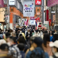 Japan's daily virus total tops 3,000, highest in over two months