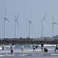 Oritsu Beach near a wind farm in Kashima, Ibaraki Prefecture, in April 2020 | BLOOMBERG