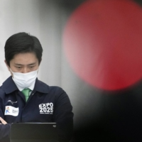 Osaka Gov. Hirofumi Yoshimura is pictured on Wednesday during a prefectural anti-coronavirus task force meeting at which the prefecture decided to declare a medical state of emergency amid surging virus infections. | KYODO
