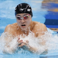 Shoma Sato competes in the men's 200-meter breaststroke final at the national swimming championships at the Tokyo Aquatics Centre on Wednesday. | KYODO