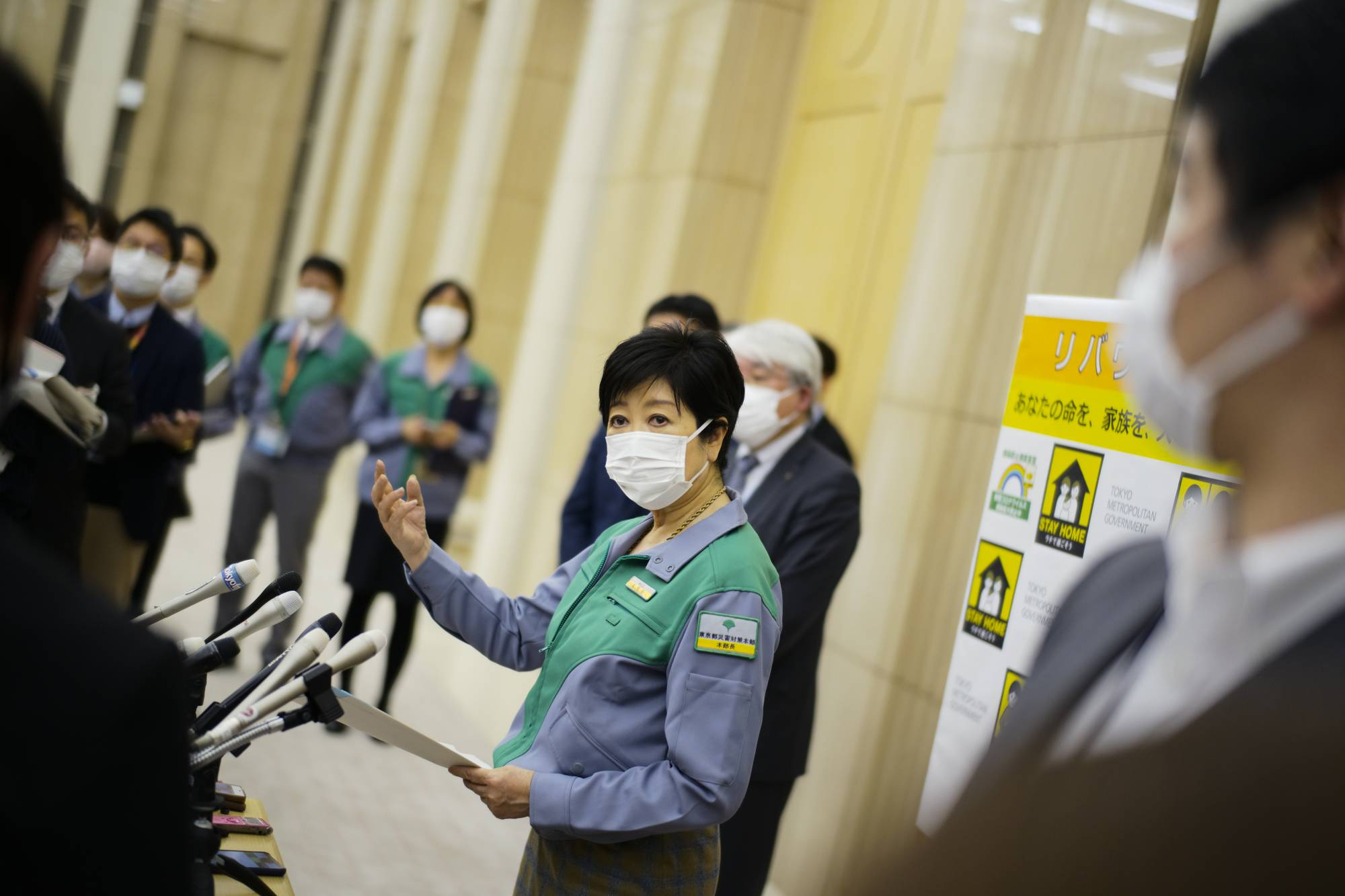 Tokyo Gov. Yuriko Koike speaks with reporters Thursday after requesting the government allow stricter coronavirus measures in the capital. | RYUSEI TAKAHASHI