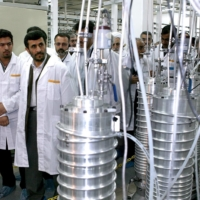 Then-Iranian President Mahmoud Ahmadinejad (second from the left) visits the Natanz nuclear enrichment facility in April 2008. | HANDOUT / VIA REUTERS