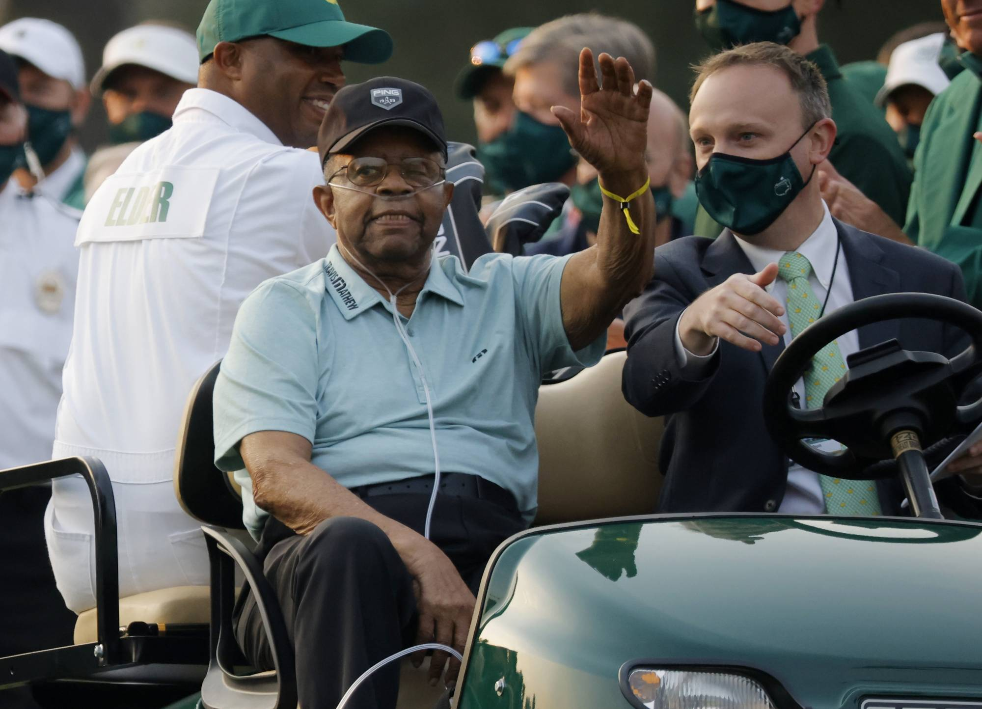 Honorary starter Lee Elder waves before the ceremonial start of the Masters in Augusta, Georgia, on Thursday. | REUTERS