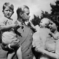 The Royal British couple — Queen Elizabeth II, and her husband, Prince Philip, Duke of Edinburgh — with their two children, Charles, Prince of Wales, and Princess Anne, in 1952. | VIA AFP-JIJI