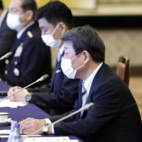 Foreign Minister Toshimitsu Motegi (right) and Defense Minister Nobuo Kishi (center) attend the Japan-U.S. 'two-plus-two' meeting in Tokyo last month. The foreign and defense ministers of Japan and India are planning to hold their own two-plus-two talks in Tokyo later this month. | BLOOMBERG