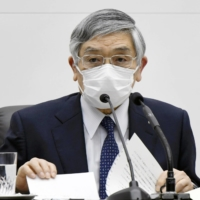 Haruhiko Kuroda, governor of the Bank of Japan, speaks during a news conference in Tokyo on March 19.  | BLOOMBERG