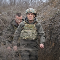 Ukraine President Volodymyr Zelenskiy visits positions of armed forces near the front line with Russian-backed separatists in the country's Donbass region on Friday.   | UKRAINIAN PRESIDENTIAL PRESS SERVICE / VIA REUTERS