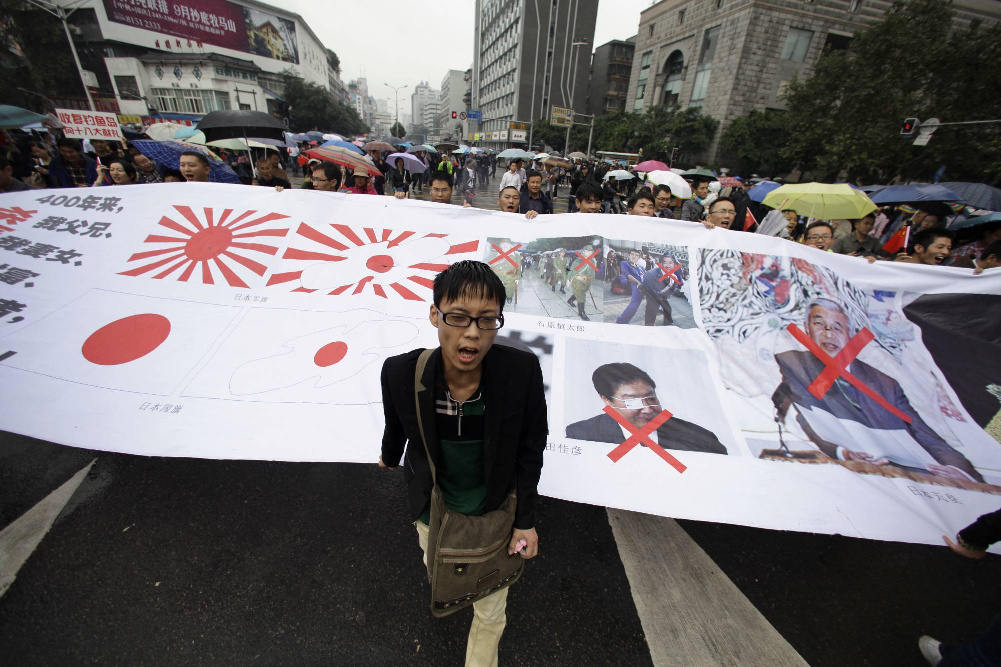 Demonstrators protest against Japan's decision to purchase the disputed Senkaku Islands, called  Diaoyu in China, in the Chinese city of Chengdu in September 2012.    | REUTERS