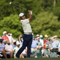 Hideki Matsuyama hits his tee shot on the 12th hole during the final round of the Masters in Augusta, Georgia on Sunday. | REUTERS