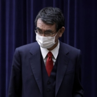 Taro Kono, Japan's vaccine point man, has said the rate of COVID-19 inoculations is unlikely to pick up speed until May. | BLOOMBERG
