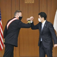 Japan defense chief and top U.S. commander in Pacific vow to deepen security ties