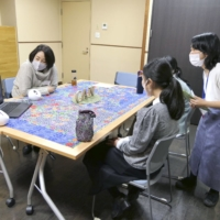 Young carers including online participants share their problems and experiences in Tokyo in November. | CARER ACTION NETWORK ASSOCIATION / VIA KYODO