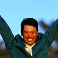 Hideki Matsuyama celebrates with his green jacket after winning The Masters in Augusta, Georgia, on Sunday. | REUTERS