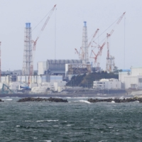 Tons of treated radioactive water accumulating at the crippled Fukushima No. 1 nuclear power plant will be released into the sea. | KYODO