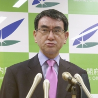 Vaccine rollout minister Taro Kono warns against wasting COVID-19 vaccine shots during a news conference on Tuesday. | KYODO