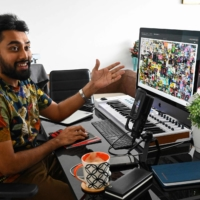 Entrepreneur Vignesh Sundaresan displays the digital artwork 'Everydays: The First 5,000 Days' by artist Beeple at his home in Singapore. | AFP-JIJI