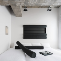 The monotone, abstract artworks in Daisuke Motogi's 'Framed Function' room for BnA_Wall can be removed and used as furniture. |
