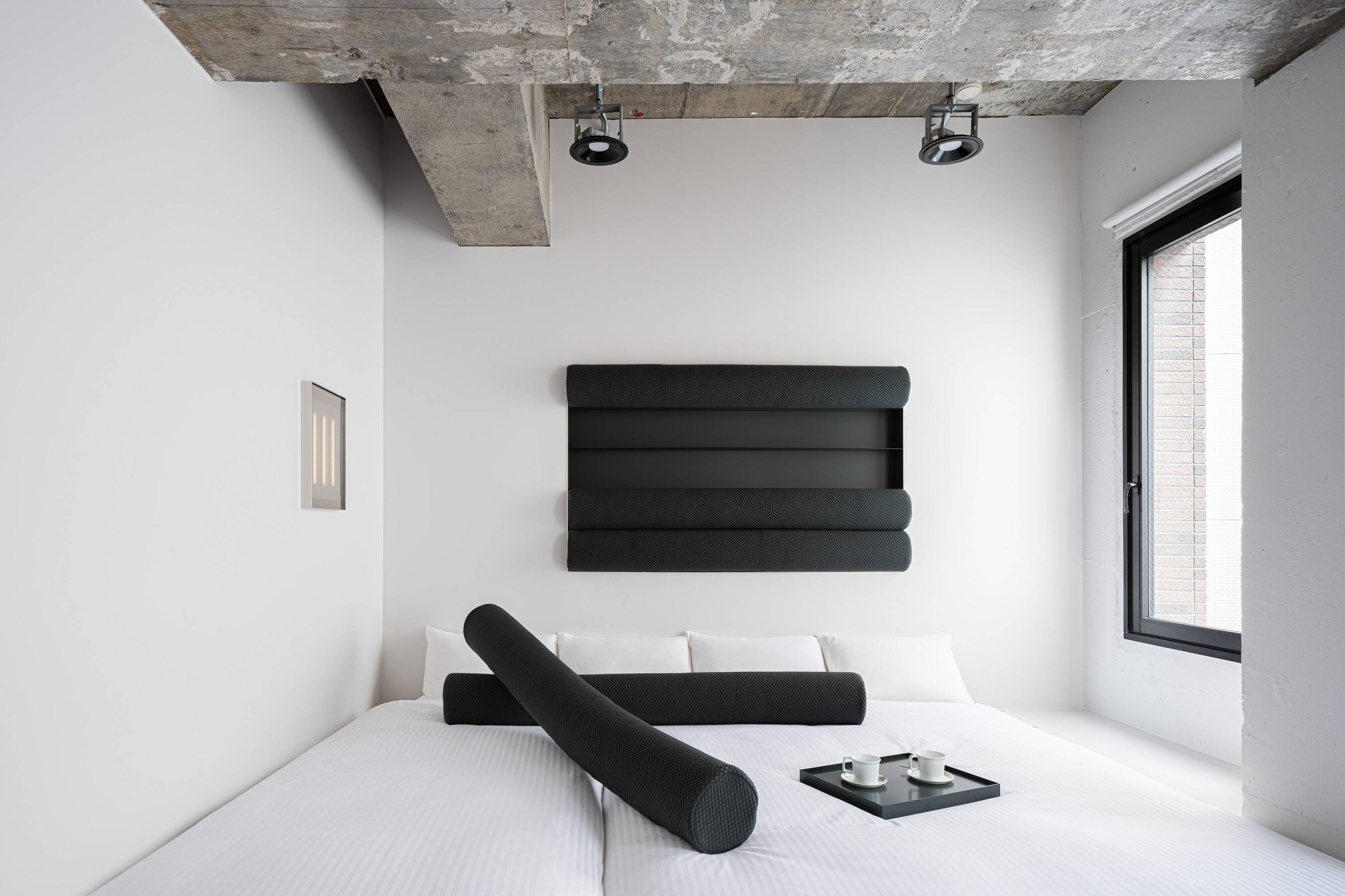 """The monotone, abstract artworks in Daisuke Motogi's """"Framed Function"""" room for BnA_Wall can be removed and used as furniture."""