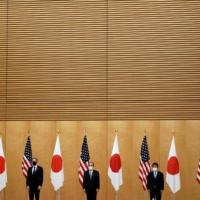 U.S. Secretary of State Antony Blinken and Defense Secretary Lloyd Austin meet with Prime Minister Yoshihide Suga, Foreign Minister Toshimitsu Motegi and Defense Minister Nobuo Kishi at the Prime Minister's Office in Tokyo on March 16. | POOL / VIA REUTERS