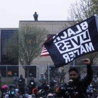 Protesters rally outside the Brooklyn Center Police Department on Tuesday.    REUTERS