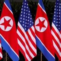 U.S. and North Korean national flags are displayed at the Capella Hotel on Sentosa island in Singapore on June 12, 2018. | REUTERS