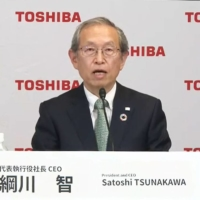 Satoshi Tsunakawa, who returned to the post of Toshiba Corp. president, speaks in an online news conference Wednesday. | KYODO