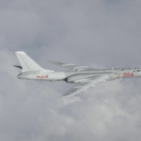 A Chinese H-6 bomber flies over East China Sea in July 2019. The Chinese military has ramped up its activities in the waterway as its capabilties grow more powerful. | JOINT STAFF OFFICE OF THE DEFENSE MINISTRY OF JAPAN / VIA REUTERS