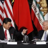 Xi Jinping, China's vice president at the time, speaks during a meeting with former U.S. Vice President Joe Biden in Los Angeles in February 2012. When Biden meets Prime Minister Yoshihide Suga later this week, China is expected to be the top issue of their discussions. | REUTERS