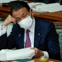 Deputy PM Aso challenged by China to drink treated Fukushima water
