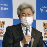 Toshio Nakagawa, president of the Japan Medical Association, speaks at a news conference in Tokyo on Wednesday. | KYODO