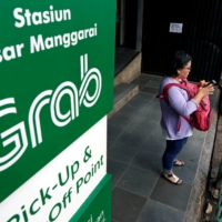 A pickup point for the online ride-hailing service Grab at the Manggarai train station in Jakarta  | REUTERS