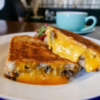 The toasties at Deeney's are made with buttery bread, pushed down with cast irons on the griddle to crispy perfection.