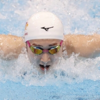 Rikako Ikee competes in the 100-meter butterfly final at the national swimming championships on April 4. | KYODO