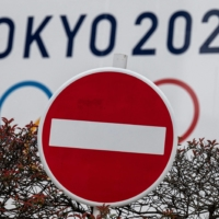 While Olympics organizers announced in March that fans from overseas would be banned from attending, the debate over the degree to which domestic spectators will be capped continues to be divisive. | AFP-JIJI