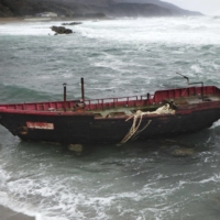 A boat believed to be from North Korea is washed ashore on the coast of Aomori Prefecture in November 2019.
