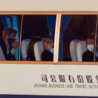 A vehicle carrying U.S. climate official John Kerry in Shanghai on Wednesday | REUTERS