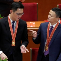 The best known billionaire made an example of by Beijing is Jack Ma (right), founder of Alibaba Group Holdings Ltd. Tencent Holdings Ltd.'s Pony Ma (left) was also recently called in by Beijing's watchdogs to discuss antitrust compliance issues. | REUTERS