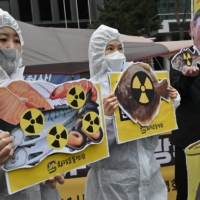 South Korean environmental activists protest against Japan's decision on releasing Fukushima wastewater, near the Japanese Embassy in Seoul on Tuesday.  | AFP-JIJI