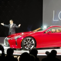 Toyota Motor Corp. President Akio Toyoda unveils the Lexus LC500 sports coupe at the North American International Auto Show in January 2016. | KYODO