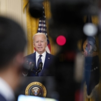 U.S. President Joe Biden said that by slapping new sanctions on Russia he was following through with a campaign vow to hold Moscow accountable for its actions, and that he could have gone further but chose to be 'proportionate.' | DOUG MILLS / THE NEW YORK TIMES